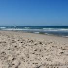 blauer Himmel und Strand