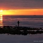 Angler am Strand